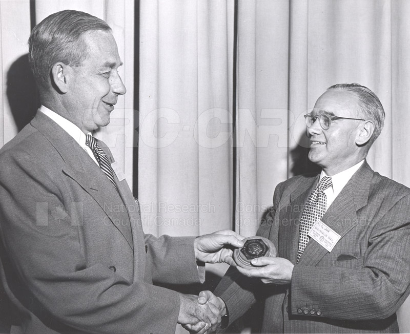E.W.R. Steacie accepting CIC Award from R.S. Jane at CIC Conference 1953