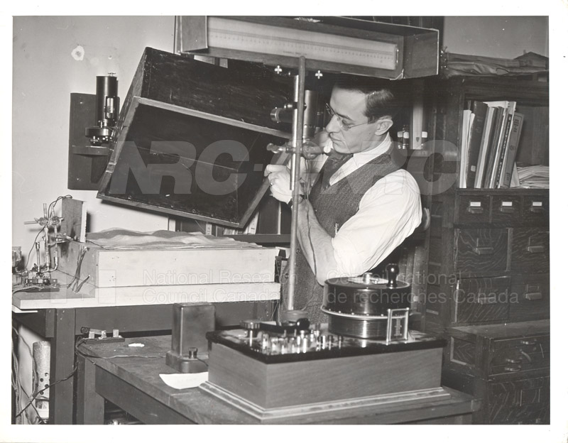 Mr. Tessier with Apparatus for Measuring Heat Transmission of Fabrics c.1940