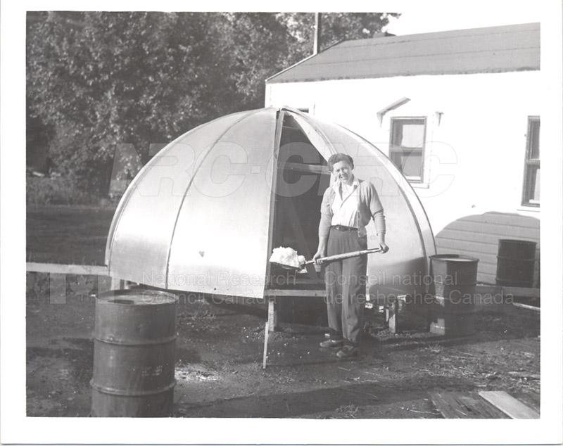 Jean Hodges Holding a Shovel July 1953